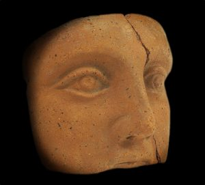 A clay-backed face. Roman votive offering. Wellcome Library, London