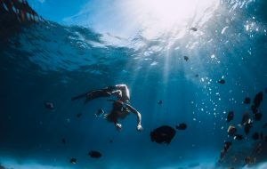 Free diver with fish