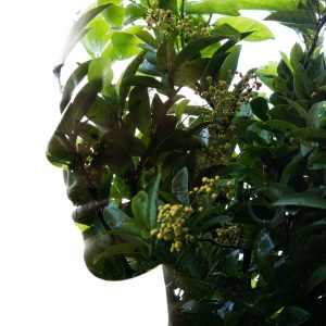 Woman with green leaves