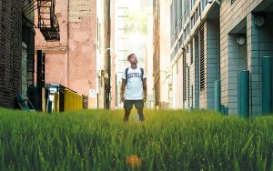 Man on grassy urban street