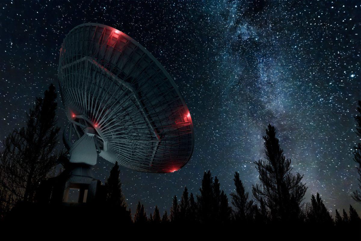 Radio telescope against night sky